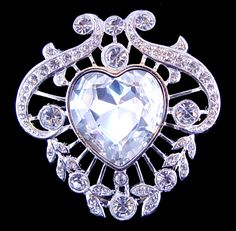 At the time Queen Mary was given the 102 Cullinan cleavings in 1910, she had no idea she was to acquire the Cambridge Emeralds which came into her possession later in the same year. The brooch made to show off the Cullinan V, an 18.8 carat hear shaped stone, then became the centre of the massive diamond and emerald Stomacher.    Queen Mary wore the brooch in 1911 pinned to simple day time dresses we wore aboard ship as she and the King travelled to India for the Delhi Durbar.