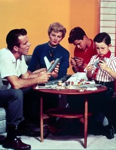 Leave it to Beaver tv show.  Ward and June always discussed what was best for the kids.  Chapter 48.  Is Wally texting in that picture ;)