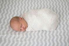 Sweet newborn baby girl in home session