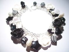 Black and White Rose Cabochon Charm Bracelet With Acrylic Charms and Beads £10.00
