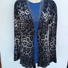 Amber Sun Long Cheetah Print Cardigan Beautiful grey,black and ivory cheetah print long sweater.  Good condition. Size small Amber Sun  Sweaters Cardigans