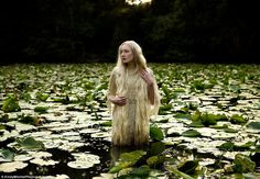 Lady of The Lake: a model emerges from a pool of lilies amidst the forest - Kirtsy Mitchell - photographer