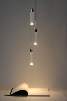 Archilume Suspended Lights by Saleem... They look like Voss water bottles..