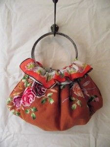 Handmade bag by Leslie Oschmann. (made from vintage embroidered linens & silk scarves. The handles are metal embroidery hoops!)