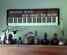 Old pump organ key board w Amazing Grace from old hymnal taped to top. Some of ducks father craved