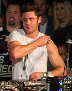 Zac Efron, 27, stole the show from his gorgeous co-star Emily Ratajkowski after putting his muscly biceps on show in a tight fitting white T-shirt as the pair continue their promotional tour in California