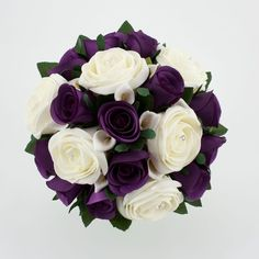 "Let the ""drama"" in your wedding be the contrast of the white against the dark purple. Wedding Bouquet Purple Silver Wedding Flowers found on Polyvore by britney"
