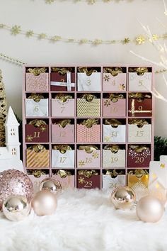 Glam Pink & Gold Reusable DIY Advent Calendar - Swoon Worthy - - Not into your traditional Christmas decor? You'll love this super easy GLAM DIY Advent Calendar that uses plenty of pink & gold! Get the tutorial here! Reusable Advent Calendar, Advent Calendar Boxes, Advent Box, Homemade Advent Calendars, Advent Calendars For Kids, Advent Calenders, Diy Calendar, Advent Calendar Fillers, Advent For Kids