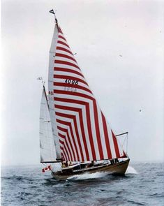 red-striped sail boat