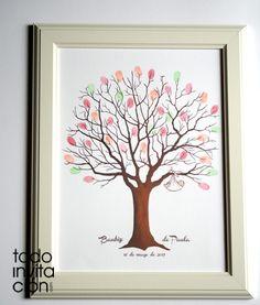 Cuadro árbol de huellas para que los invitados de su bautizo dejen su huella y su firma. Un precioso árbol con un hatillo de bebé colgado de sus ramas.