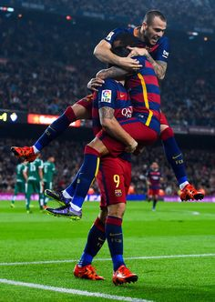 Luis Suarez (L) of FC Barcelona celebrates with his teammates Neymar and Sandro Ramirez of FC Barcelona after scoring his team's second goal during the La Liga match between FC Barcelona and SD Eibar at Camp Nou on October 25, 2015 in Barcelona, Catalonia.