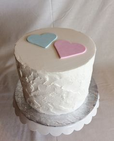 Sweet and simple gender reveal cake | gender reveal | textured buttercream | rustic texture | hearts | pink and blue