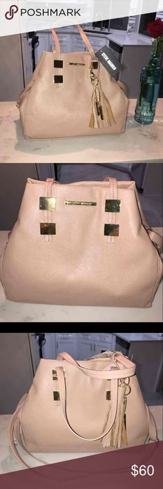 NWT Steve Madden Blush Purse The color is gorgeous! It's Blush pink and has gold accents and cute Tassel on strap Steve Madden Bags Shoulder Bags