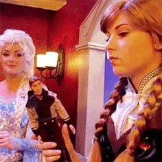 """Anna with a Hans doll. It looks like Elsa is saying """"slap him!"""""""