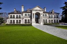 This stately Colonial style mansion is located at 2290 Saxony Court in Mississauga, Ontario, Canada. Itwas built by renownedAmbassadorFine Custom Homes in 2009 and is situated right next to theMis