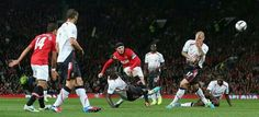 Wayne Rooney takes shot on goal in match against Liverpool.