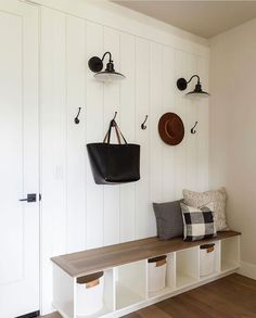 It always makes me happy when I see designers create something within reach. You can easily do this mudroom on a buget. This area has texture and simplicity with character-adding in the baskets, hooks and farmhouse capital sconces. Love it @laurensmythdesign. Photo and styling by @andimarshallinteriors #mudroom #mudroomideas #mudroombench #mudroomideasonabudget #shiplap #mudroomsDIY #mudroomsmall #mudroomfarmhouse #utilityroom #utilityroomideas #utliltyroomsmall #mudroomorganization