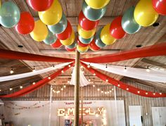 Circus-Themed Party Decor - love the lights, fabric and balloons that really bring this circus party to life! #partyidea #kidsparty