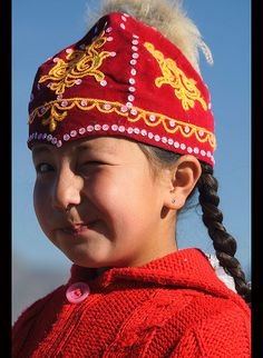 portrait of a Kazakh girl in the Altai Region of Bayan-Ölgii in Western Mongolia | By jitenshaman / dave stamboulis