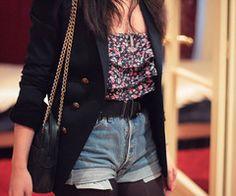 black blazer floral top black belt black purse denim shorts black panty hose