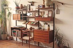 I wish I had this on my wall. - Danish Mid Century Modern Modular Teak Wall by OTHERTIMESvintage