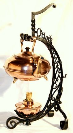"""Bradley & Hubbard copper teapot on stand, o'clock tea"""", Century antiques """"Bright copper kettles and warm woolen mittens."""