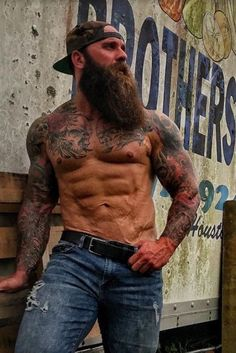 Excellent build, tattoos and beard.
