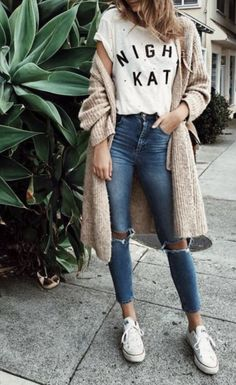 Jeans and Tee: a simple graphic printed white tee with denim jeans a beige large cardigan and Converse white sneakers.