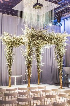 Custom #ceremony canopy made of branches and #white florals | Photography…