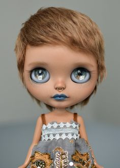 Base Doll: Cherry Beach Sunset (RBL+, dark tan skin) Work Done: +Carving of lips (open, with teeth), philtrum, and nose with septum piercing. +Face...