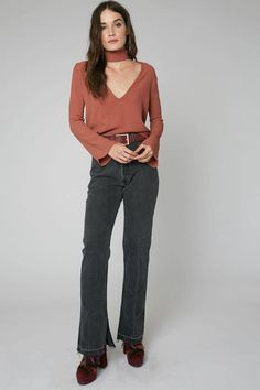 Long sleeve top with exposed front and attached choker Plunging neckline Color Saffron Model is wearing a small 100% Rayon Designed in Venice, Los Angeles Dry Clean   Memphis Top Saffron by Flynn Skye. Clothing - Tops - Long Sleeve Clothing - Tops - Casual California