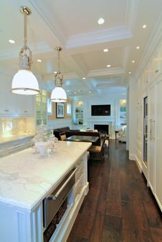 Beautiful white kitchen with recessed lighting in coffered ceiling as well as dark stained wide-plank wood floors. Beautiful Kitchens, Cool Kitchens, White Kitchens, Küchen Design, House Design, Design Ideas, Interior Design, Design Inspiration, Dark Wood Floors