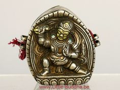 Antique Tibetan (travel) amulet holder, so called 'Gau', in silver and gold plated details. Back piece in copper, decorated with turquoise and the representation of Vajrapani, height 7 cm. http://www.little-buddha.net/antique_buddha_art/
