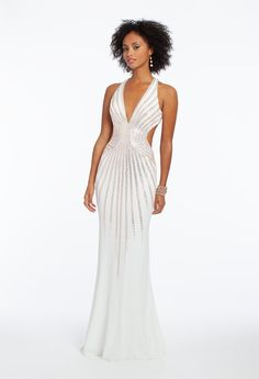 Set the bar high in this elegant stunner: from the sexy plunging halter neckline and fitted crystal beaded cutout bodice, to the flattering mermaid silhouette and open back, this long prom dress is the sleek style you need this season. Make the details pop with rhinestone heels, multi stone earrings and a satin bow clutch. #CamilleLaVie