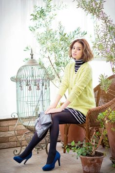 Model / Cecil Kishimoto. Lemon yellow knit and blue pumps and stripe knit dress. Cute fashion by Image.