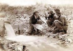 """Above we show a majestic photo of """"We have it rich."""" Washing and panning gold, Rockerville, Dakota Territory. Old timers, Spriggs, Lamb and Dillon at work. It was made in 1889 by Grabill, John C. H., photographer."""