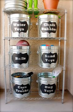 Organizing Outside Toys with Buckets at Domestic Charm; need these metal shelves too; could organize sidewalk chalk, etc. so it all stays outside where it belongs! Lol