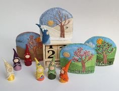 Perpetual calendar with Waldorf inspired, replaceable, embroidered and partly needle felted season background covers, and tiny days of the week gnomes wearing delicately embroidered felt clothes, uniquely designed according to the astrological symbology of the days (followed by