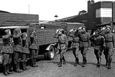 """May 18, 1940. German and Dutch soldiers salute each other. After the capitulation of the Dutch army on May 15, 1940 only 20,000 of the 300,000 Dutch military personnel were detained in POW camps. As a gesture of good will they were released by order of Hitler in June 1940. Hitler had chosen this option for ideological reasons: the Dutch were a """"related brother people"""" and Hitler wanted to win them over to National Socialism. It did not work. Photo ANP / Co Zeylemaker #amsterdam#wordwar2"""