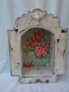 Distressed white painted nicho / shrine with vintage pink and blue roses background