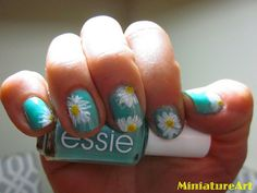 Daisy flower manicure! Did this one this week...of course the last daisy on my last finger turned out horrible, more like a little fried egg on my finger than a daisy....but the rest were great!