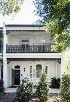 A black and white Victorian terrace facade.