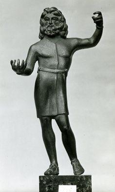 1stC Gallo-Roman Bronze statuette of the Celtic god Sucellus, wearing a Gallic tunic.