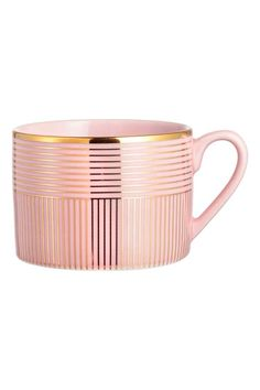 Patterned mug: Print-patterned porcelain mug. Height 6.5 cm, diameter 9 cm.