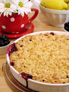 Blueberry Cobbler by WickedGoodKitchen.com ~ Best ever blueberry cobbler with juicy filling and buttery biscuit crumble topping...like a combination of pie pastry, buttery biscuits and shortbread sugar cookies