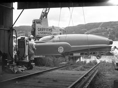 Donald Campbell's Bluebird K7 Water Speed Record boat being put into the water by crane