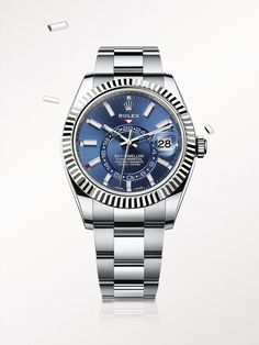 The Rolex Sky-Dweller in steel and white gold, with a blue dial and Oyster bracelet.