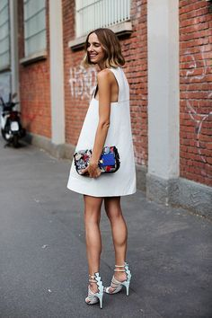 such a great white dress for summer, balanced out with some key accessories.