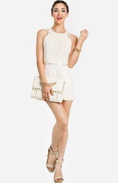 An all white outfit is so fresh for summer, just be sure to mix in different textures and metallic accents for an interesting look. This ivory romper is perfect for a naughty night out with the girls.