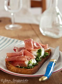 at first i thought that was a poached egg, but when i saw it was fresh mozz i was equally intrigued.    prosciutto, mozzarella, pesto
